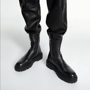 Black leather platform Chelsea biker boots